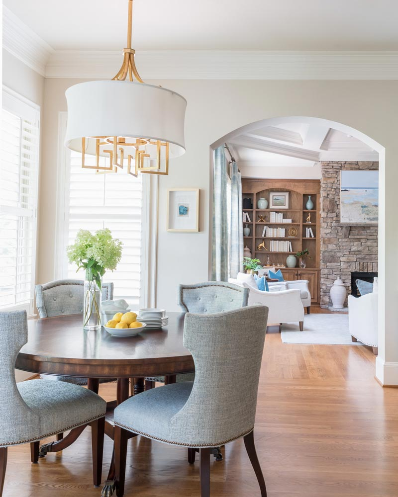 Bright, white dining table space in a New Traditional home designed by Lynn Blackwell South Carolina based Interior Design Group.