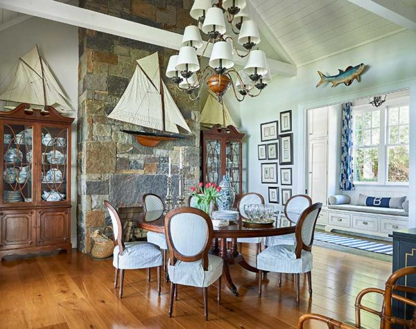 This hamptons wannabe dining room is furnished with new and vintage furnishings, mounted fish and lots of nautical accessories. We slipcovered the lee industrieschair seats to create a more casual, vintage vibe.